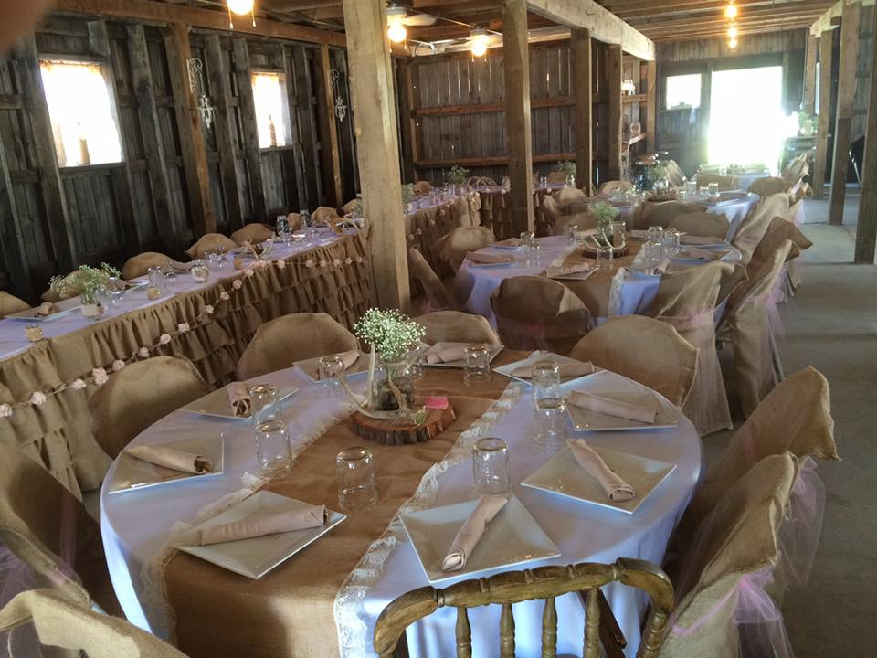 Beautiful picture of tables setup in the barn.