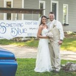 The Bride and Groom in front of our company sign.