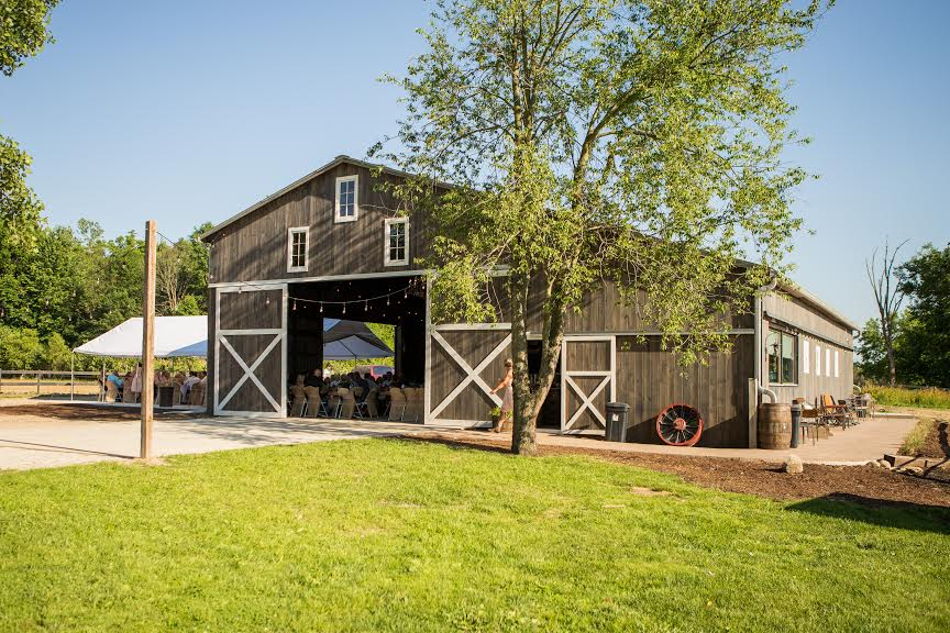 Beautiful picture of the barn with doors open during the reception.