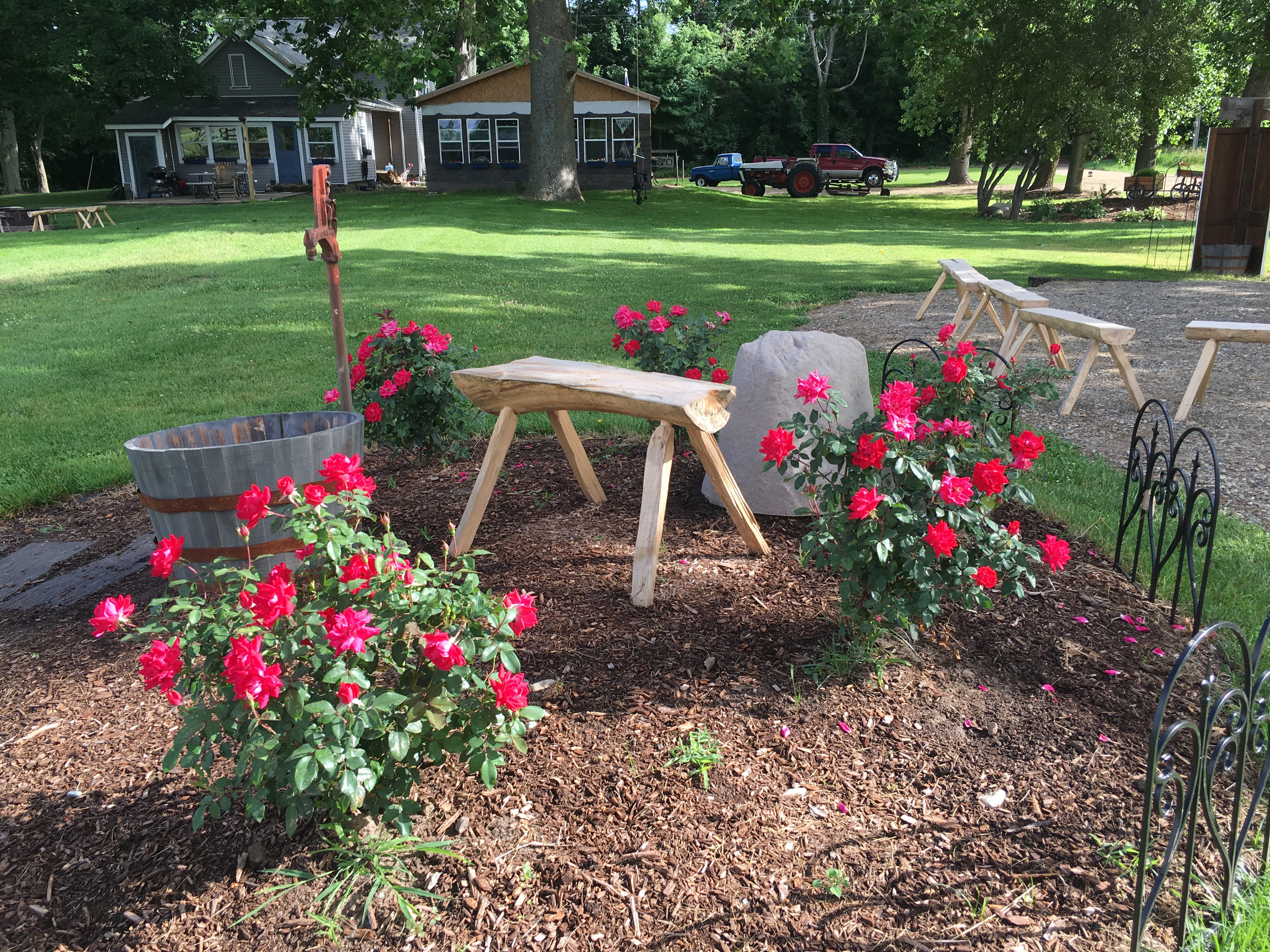 Amazing flowers and landscaping done with homemade benches.
